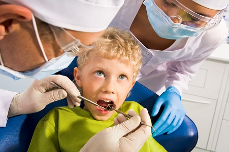 dentist examining a boy, Baby Bottle Tooth Decay Dothan